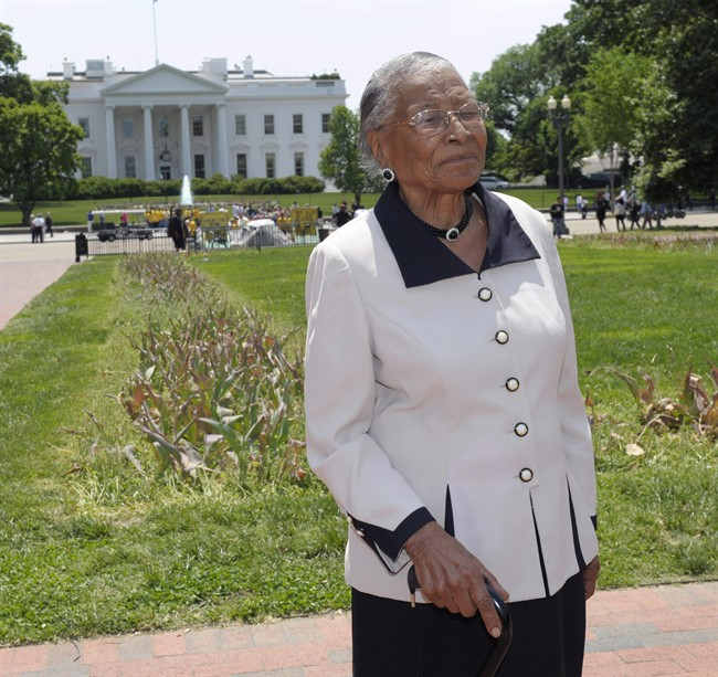 Recy Taylor stands in Lafayette Park, Thursday, May 12, 2011, after touring the White House. Taylor has a picture of President Barack Obama and first lady Michelle Obama in the living room of her home in Florida. She never imagined she would visit the Obamas' house in Washington. Taylor is touring the nation's capital nearly seven decades after she was denied justice following a brutal assault. In 1944, Taylor, who is black, was a 24-year-old wife and mother living in Abbeville, Ala. Seven white men kidnapped and sexually assaulted her and then left her on the side of the road. Two grand juries, made up of white men, refused to indict anyone. (AP Photo/Susan Walsh).