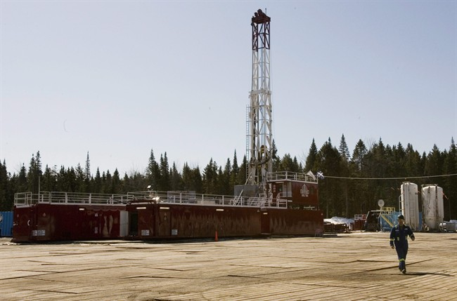 A gas worker walks from a shale gas drilling rig, on March 25, 2009 in Saint-Edouard-de-Lotbiniere Que.