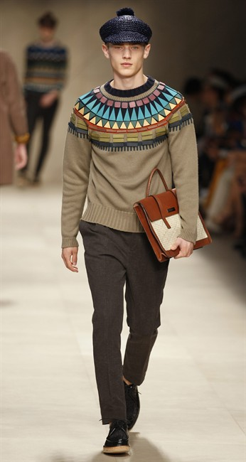 A model wears a creation of Burberry men's Spring-Summer 2012 collection, part of the Milan Fashion Week, in Milan, Italy, Saturday, June 18, 2011. (AP Photo/Luca Bruno).