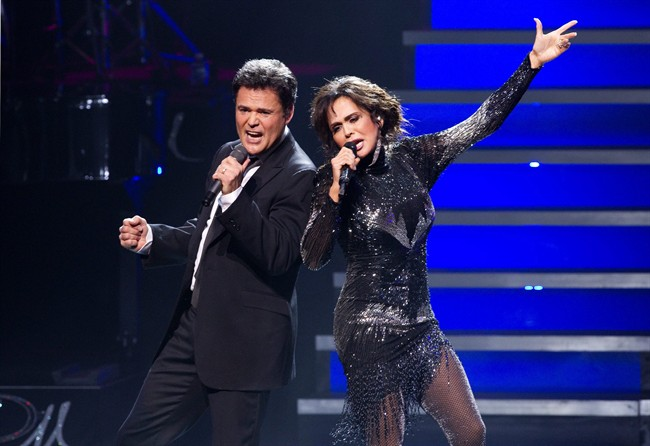 """Donny and Marie Osmond perform on the opening night of their show, """"Donny and Marie Live"""", at the Four Season's Centre in Toronto on Wednesday July 6, 2011. THE CANADIAN PRESS/Chris Young."""