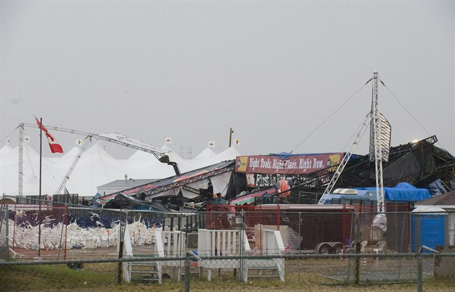 The collapsed main stage at the site of the Big Valley Jamboree in Camrose, Alta. is shown after a storm on August 1, 2009. THE CANADIAN PRESS/John Ulan.