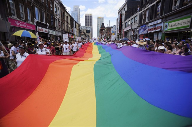 People take part in the annual Pride Parade.