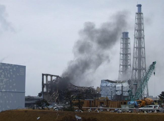 In this March 21, 2011 photo, gray smoke rises from Unit 3 of the tsunami-stricken Fukushima Dai-ichi nuclear power plant in Okuma, Fukushima prefecture, Japan.