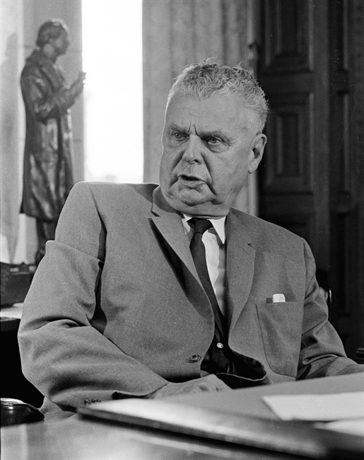 Former prime minister John Diefenbaker sits in his office in Ottawa, Aug 29, 1966. Half a century after his tumultuous six years as Canada's prime minister, Diefenbaker is seeing his name slapped on icebreakers and public buildings as the Harper Conservatives work to paint a little blue into the country's political memory.THE CANADIAN PRESS/Chuck Mitchell.