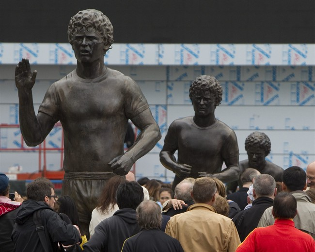 Spectators gather around statues of Terry Fox at the newly refurbished Terry Fox Plaza in downtown Vancouver, Friday, Sept. 16, 2011. THE CANADIAN PRESS/Jonathan Hayward.