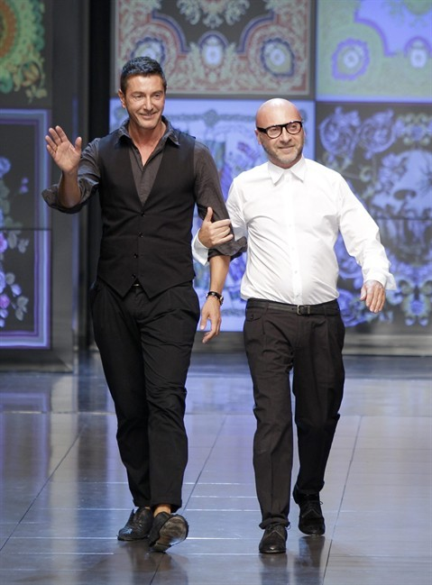 Italian fashion designers Stefano Dolce, left, and Domenico Gabbana take the catwalk after presenting their D&G women's Spring-Summer 2012 collection, in Milan, Italy, Thursday, Sept. 22, 2011. (AP Photo/Antonio Calanni).