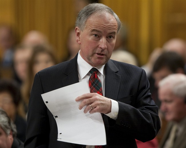 Minister of Justice and Attorney General of Canada Rob Nicholson rises during Question Period in the House of Commons on Parliament Hill in Ottawa, Thursday October 6, 2011. THE CANADIAN PRESS/Adrian Wyld.