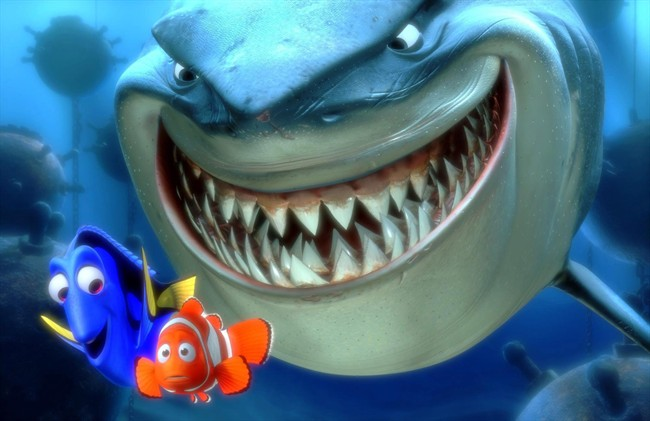 """n this promotional photo released by Disney Pixar Animation, Dory, lower left, and Marlin, lower right, face an ocean full of perils in their efforts to rescue Nemo in this scene from Pixar Animation Studios """"Finding Nemo.""""."""