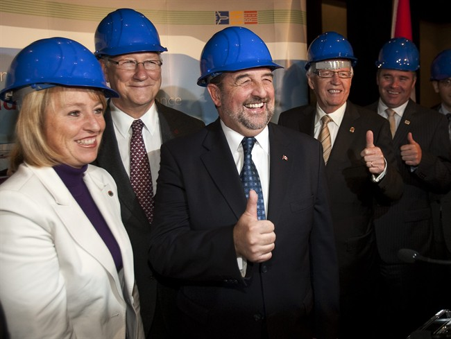 Federal Transport Minister Denis Lebel, center, poses with Longueuil Mayor Caroline St-Hilaire, left, Montreal Mayor Gerald Tremblay, 2nd left, and other dignitaries at a news conference to announce plans for a new bridge to replace the Champlain Bridge, on Wednesday, October 5, 2011 in Montreal. THE CANADIAN PRESS/Ryan Remiorz.