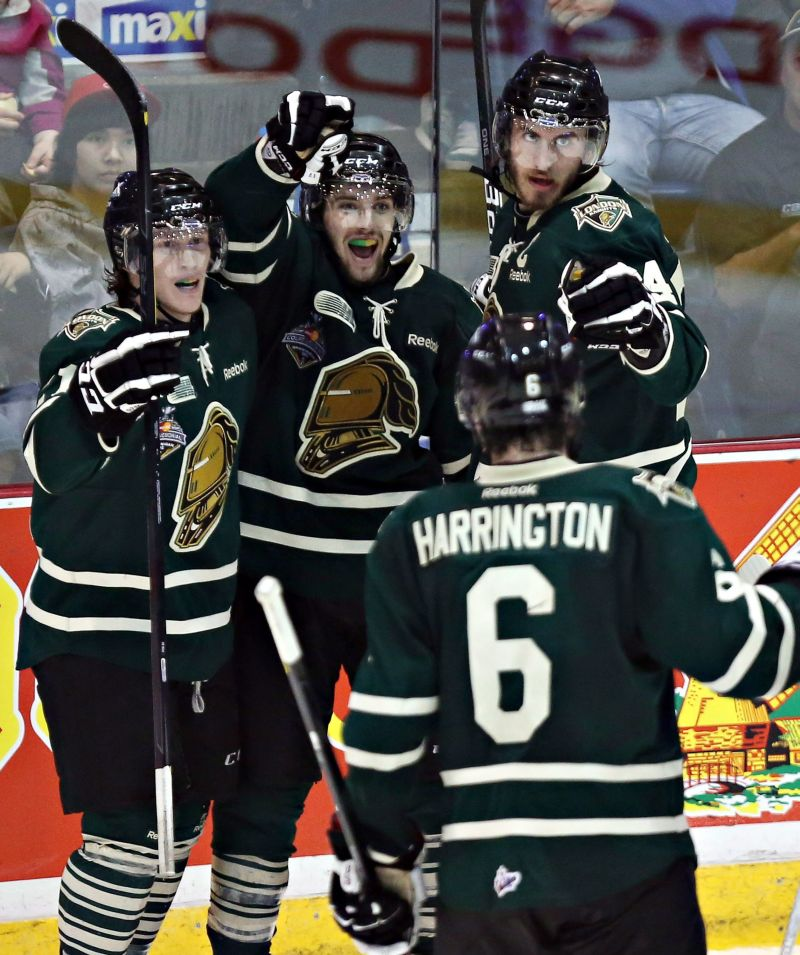 London, Ont. - Tyler Ferry, Seth Griffith, Jarrod Tinordi and Scott Harrington celebrate a London goal during the 2011-12 season.