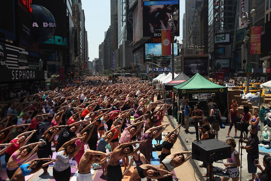 People do Bikram Yoga outside.