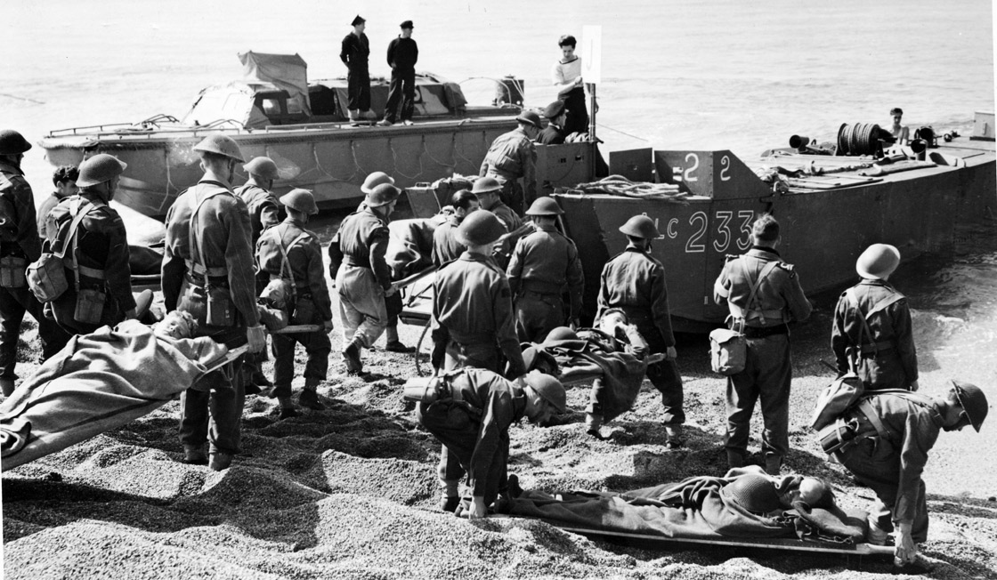 Members of the Royal Canadian Medical Corps evacuating Allied soldiers from the beach after the Dieppe, France raid during the Second World War.