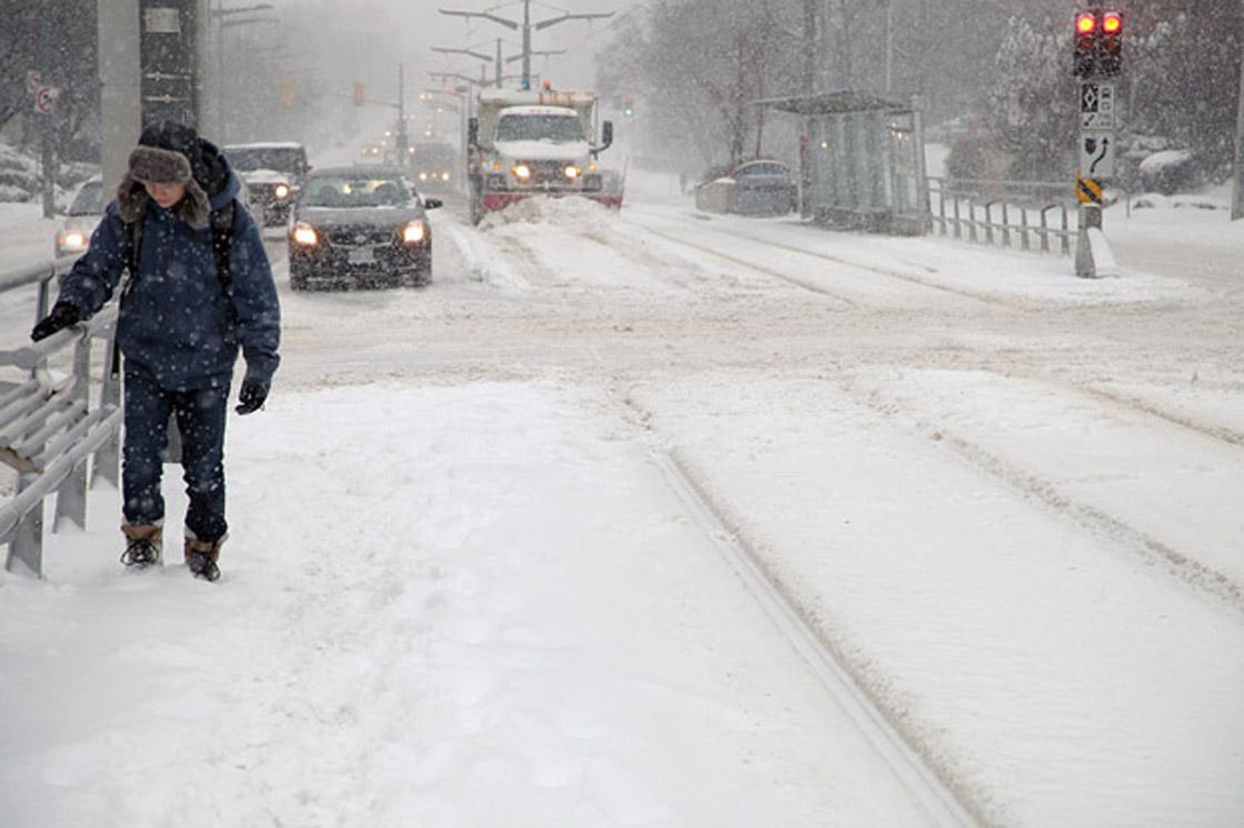 Commuters trek in snow following a storm in Toronto on Feb. 8, 2013.