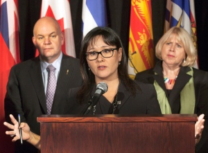 Federal Health Minister Leona Aglukkaq (centre) and Ontario Health Minister Deb Matthews clashes late last year over Ottawa's approval of generic OxyContin.
