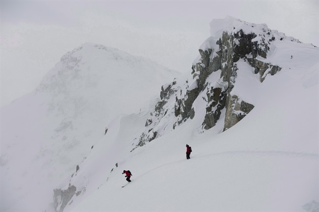 FILE PHOTO: Blackcomb mountain ski patrollers inspect the snow on Blackcomb Mountain in Whistler, B.C.