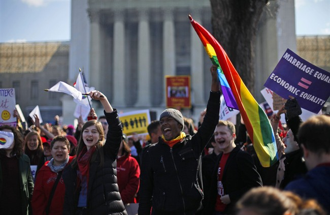 Demonstrators chant outside the Supreme Court in Washington, March 26, 2013.