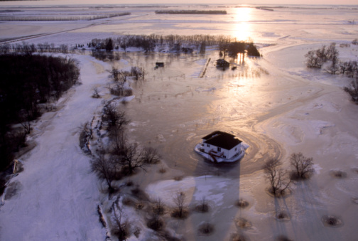 A flooded neighbourhood, once situated along the Red River, fifteen miles south of Fargo, North Dakota.