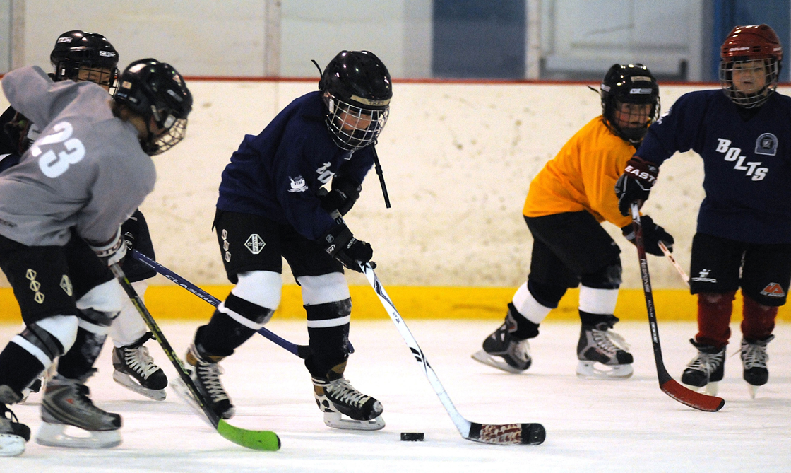 Hockey Winnipeg has barred the parents of a player from rinks for three seasons following a locker room fist fight.