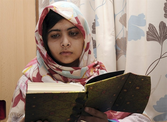 FILE - In this undated file photo provided by Queen Elizabeth Hospital in Birmingham, England, Malala Yousufzai reads a book.