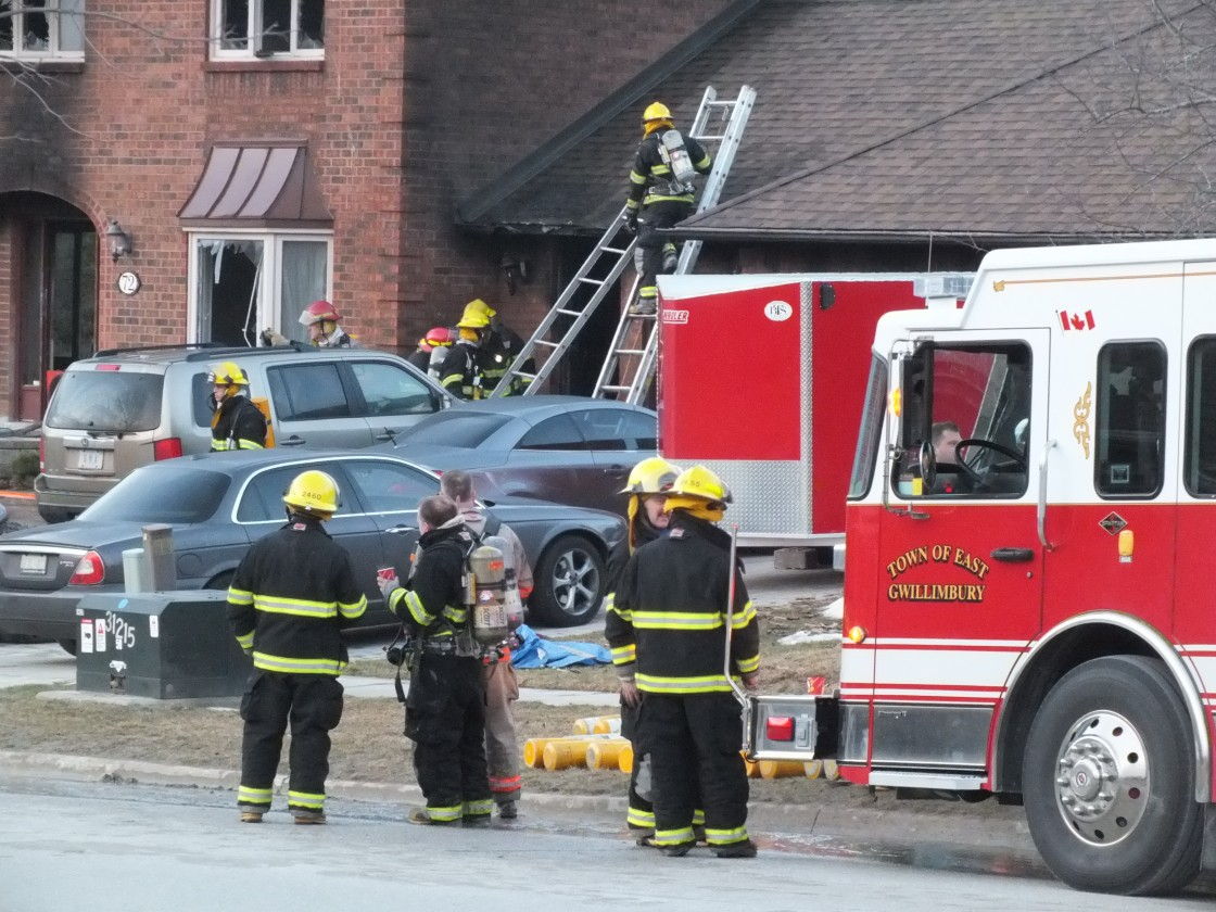 Firefighters attend to a fire at a home in East Gwillimbury on March 29, 2013.