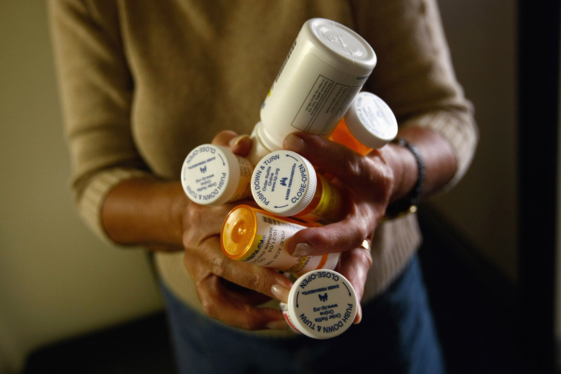 Registered Nurse Susan Eager carries a patient's medications while performing a home visit on November 4, 2009.