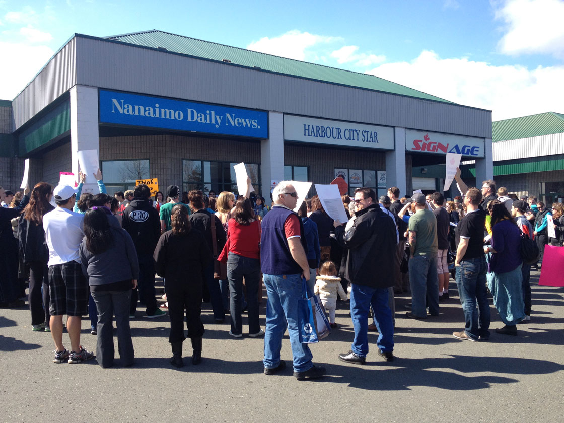 Protesters gather outside the Nanaimo Daily News office.