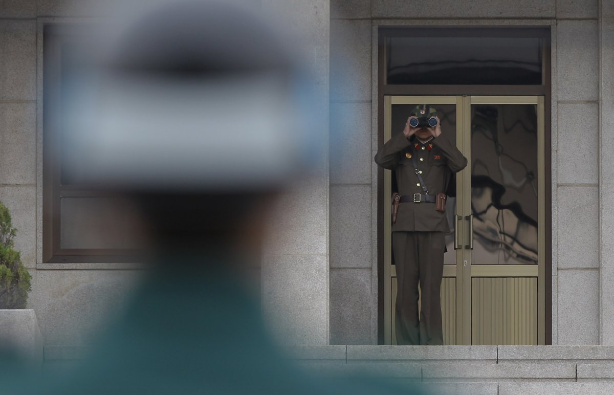 A North Korean soldier looks at South Korea across the Korean Demilitarized Zone (DMZ), on April 23, 2013 in Panmunjom, South Korea. (Photo by Chung Sung-Jun/Getty Images).