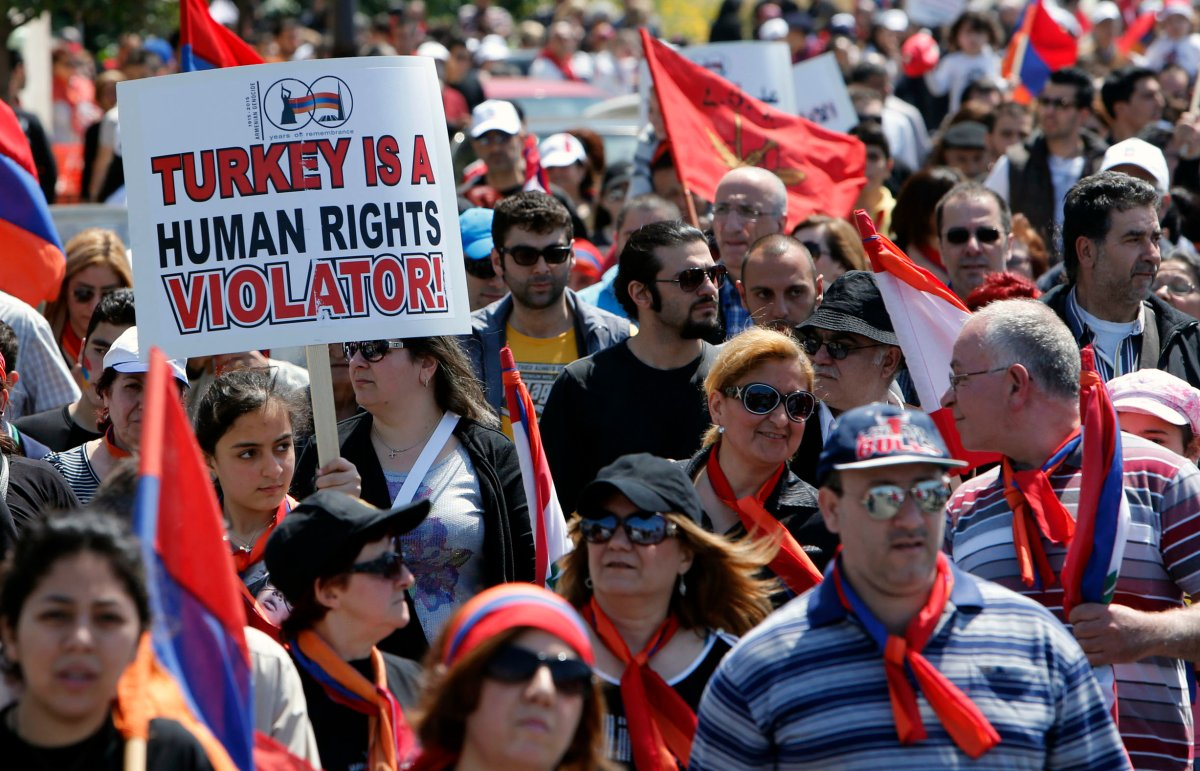 Armenians take part in a march north of the Lebanese capital Beirut, to commemorate the 98th anniversary of the Ottoman Turkish genocide against the Armenian people on April 24, 2013.