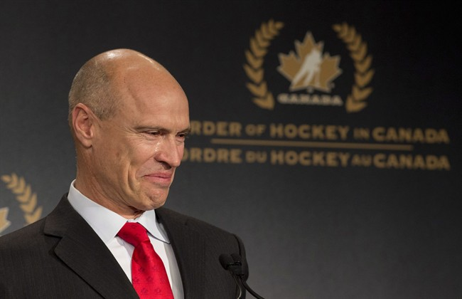 Tears roll down the cheek of former NHL great Mark Messier as he speaks during his induction into the Order of Hockey in Canada in Ottawa, Monday April 8, 2013.