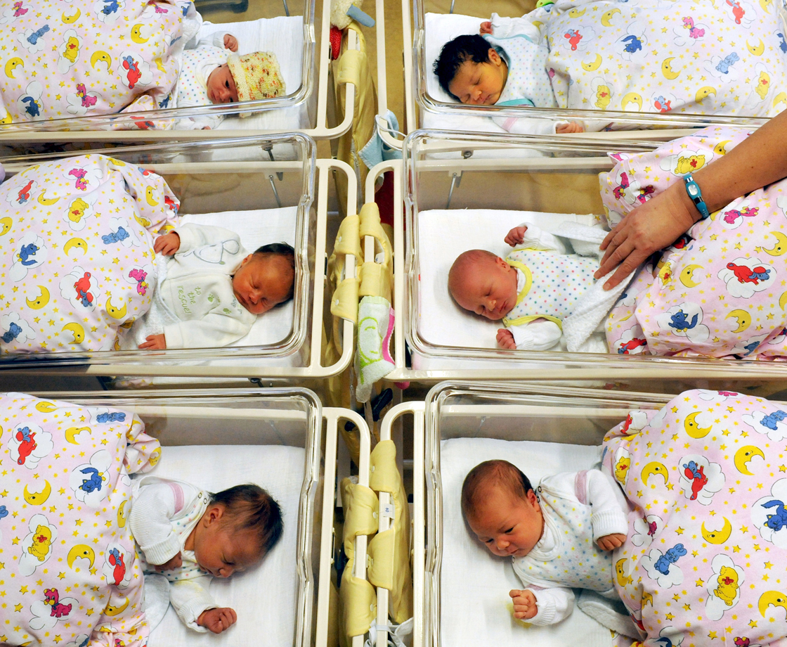 Newborn babies lay in their beds at the St. Elisabeth and St. Barbara hospital in Halle, eastern Germany, on January 2, 2012.