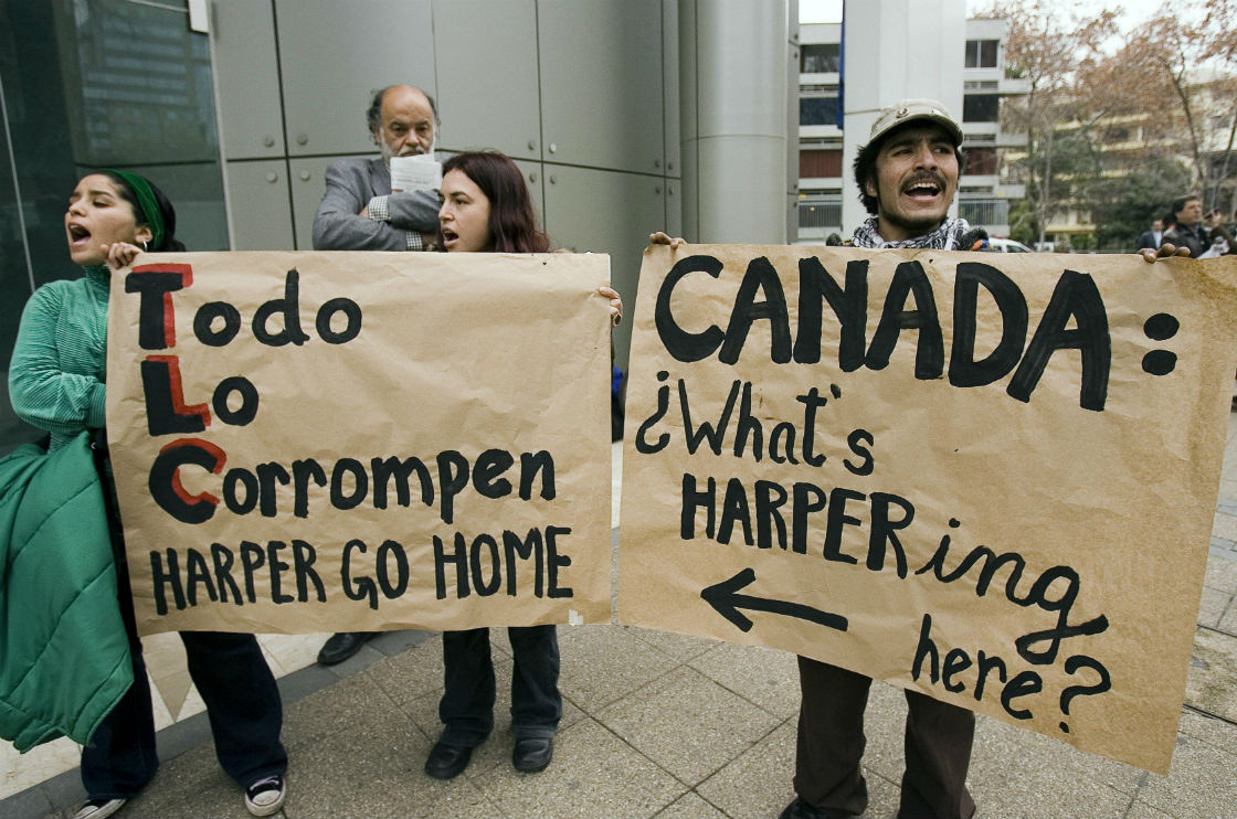 A small group of protesters demonstrate outside the offices of Barrick Gold during a visit by Prime Minister Stephen Harper in Santiago, Colombia Wednesday, July 18, 2007. The protests was against the mining company's open pit mining project in Pascua Lama, Chile. (File photo).