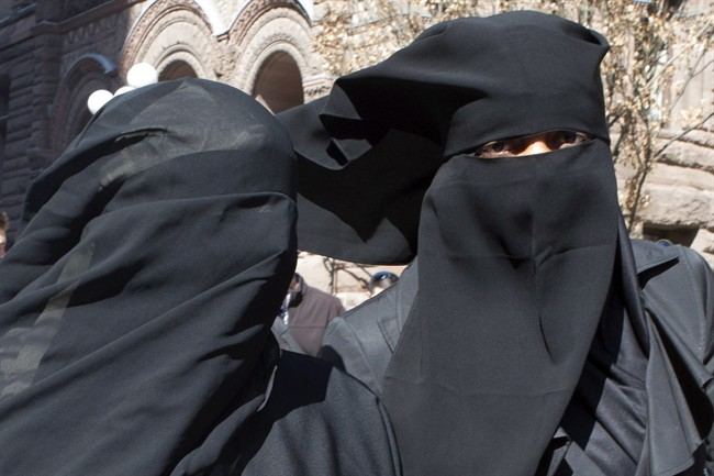 Unidentified women wear niqabs outside an Ontario court house in Toronto on Tuesday April 23, 2013.
