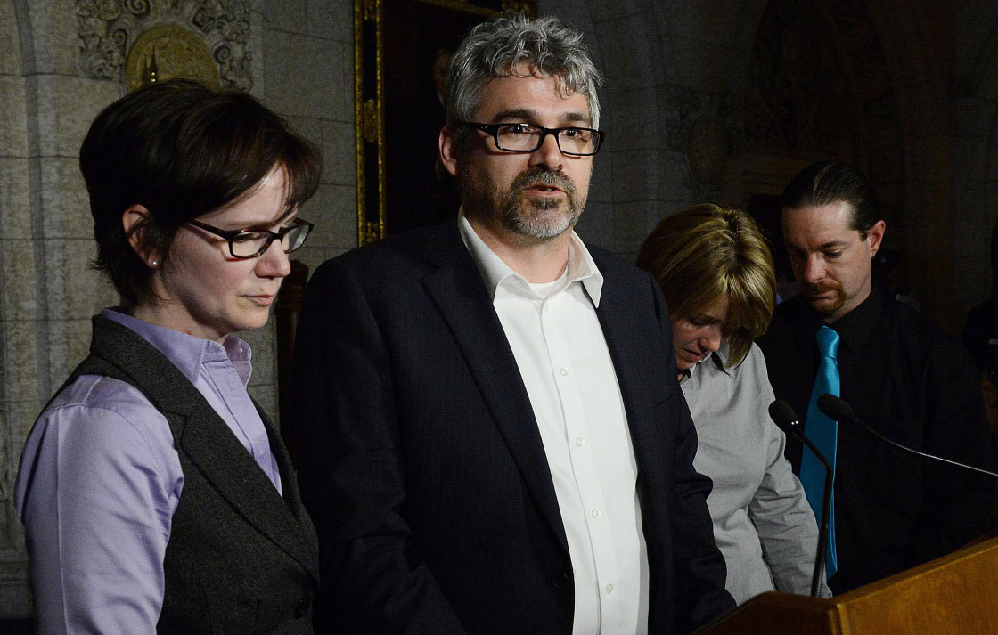 Leah Parsons, second from right, mother of Rehtaeh Parsons and her partner Jason Barnes as well as Rehtaeh's father Glen Canning, second from left, and his wife Krista speak to reporters in the foyer of the House of Commons on Parliament Hill in Ottawa on Tuesday, April 23, 2013. They were on Parliament Hill to discuss the Rehtaeh Parsons case with Prime Minister Stephen Harper.