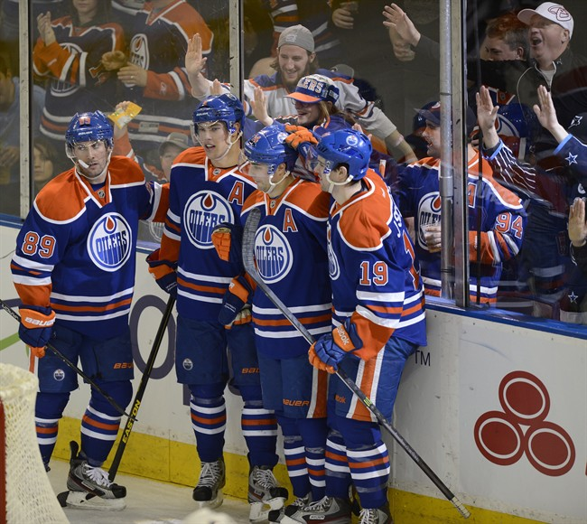 Edmonton Oilers' Sam Gagner, Taylor Hall, Jordan Eberle and Justin Schultz celebrate a goal by Eberle against the Vancouver Canucks during second period NHL hockey action in Edmonton, on Saturday, April 27, 2013.