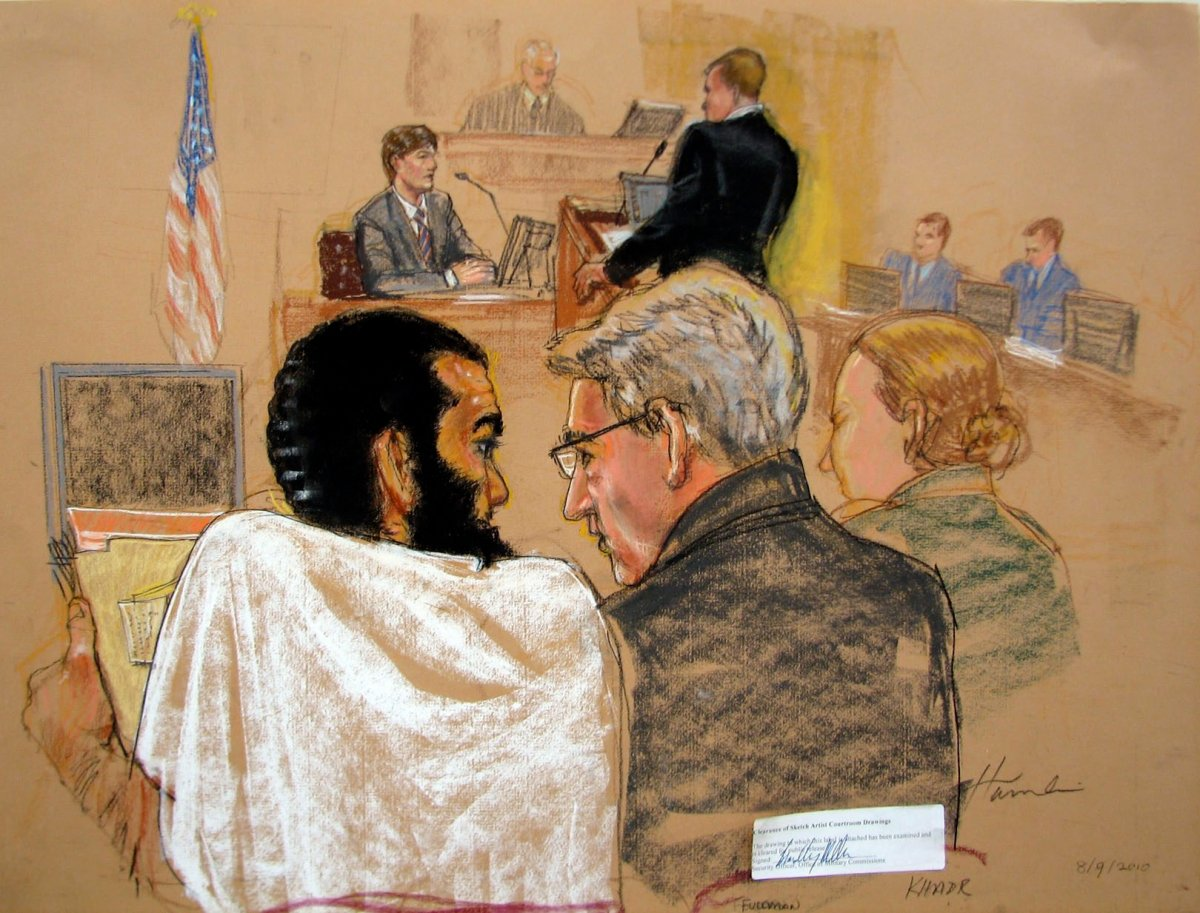 Omar Khadr sits beside lawyer Dennis Edney at a Guantanamo Bay courtroom in August, 2010.