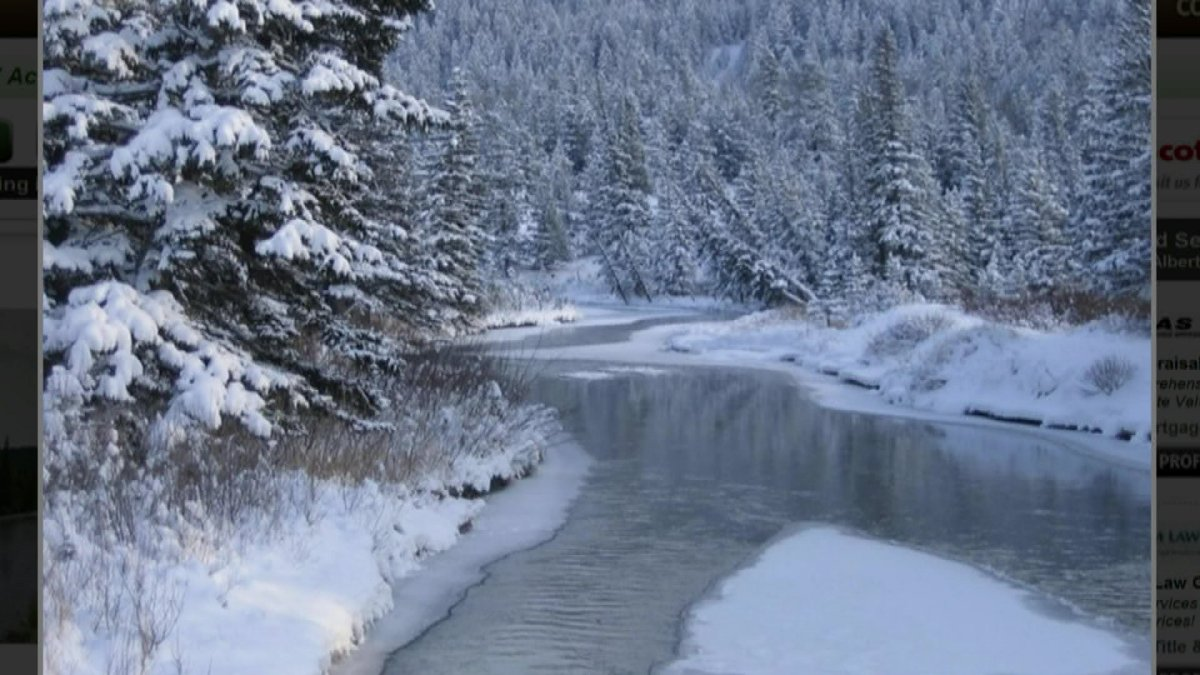 An online listing of a Coleman, AB acreage being sold for digital currency shows a view of the Crowsnest River.