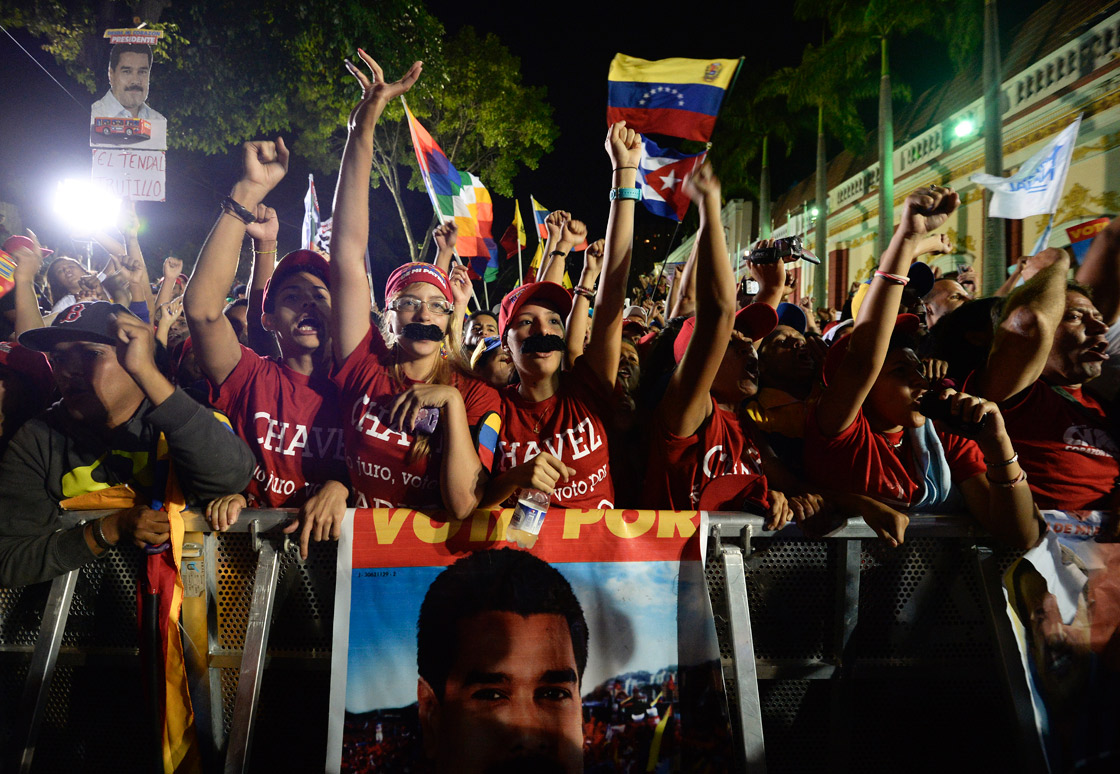 Supporters of Venezuelan acting President Nicolas Maduro celebrate after knowing the election results in Caracas on April 14, 2013.