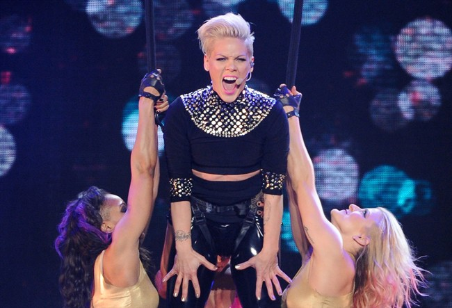 "This March 22, 2013 file photo shows singer Pink during her ""The Truth About Love"" tour at Madison Square Garden in New York. The pop singer has cancelled her concert at the Bell Centre scheduled for Friday, March 23, citing illness."