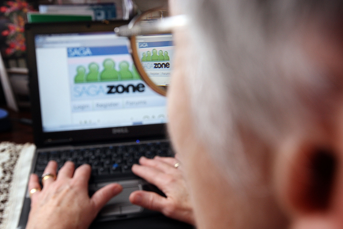 Pensioner Mary Devlin uses a laptop computer to look at the Saga Zone website on November 1, 2007 in London.