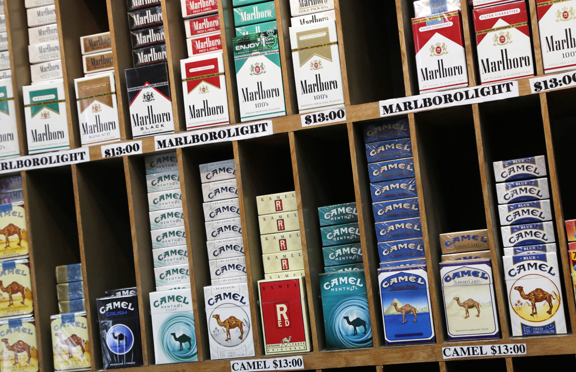 In this March 18, 2013 file photo cigarette packs are displayed for sale at a convenience store in New York.