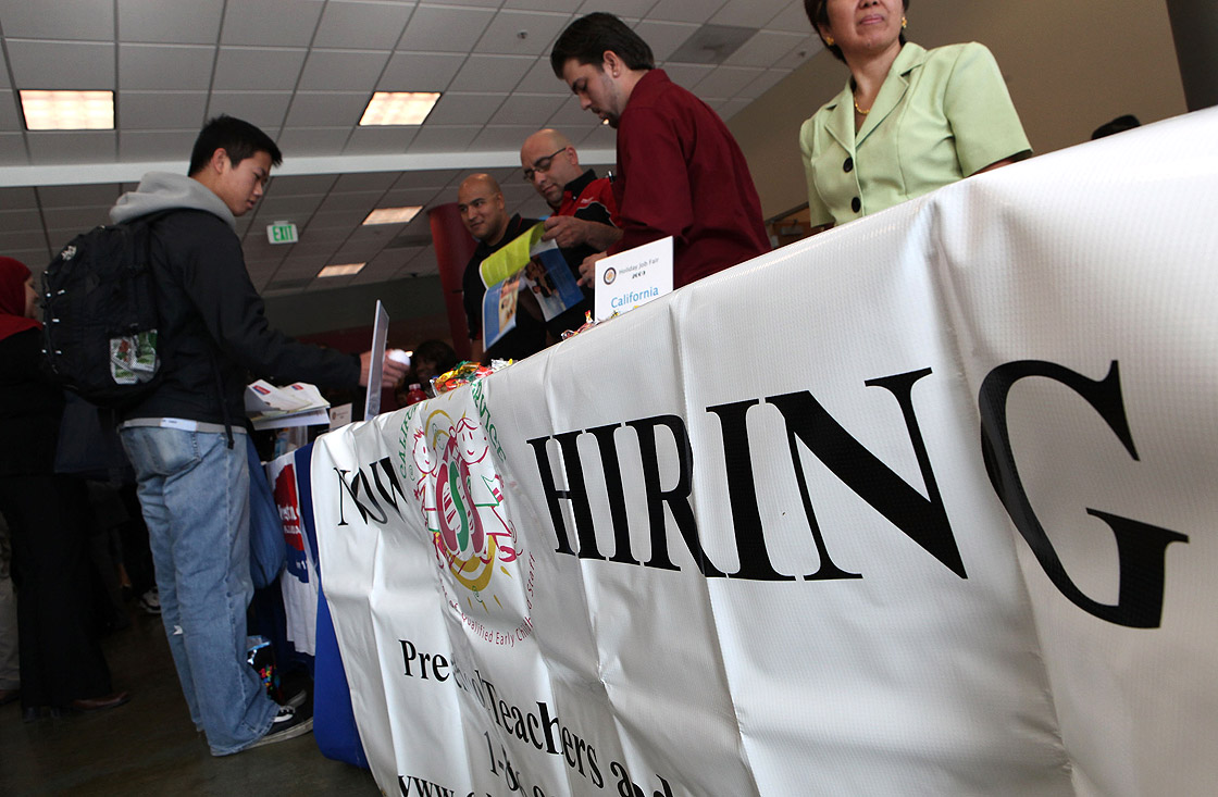 A Skyline College student talks to recruiters during a job fair November 4, 2009 in San Bruno, California.