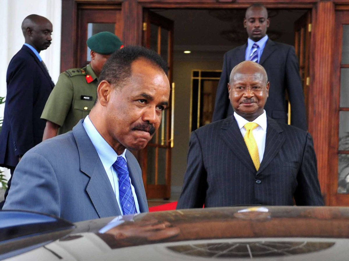 Eritrea's President, Issaias Aferworki (L) departs August 19, 2011 Entebbe State House at the end of a four-day state visit as his Uganda's counterpart, Yoweri Museveni looks on. Afeworki rejected  accusations by a UN monitoring group that he backs Somalia's extremist al-Shabaab rebels and that his country was behind a bombing plot on Addis Ababa.
