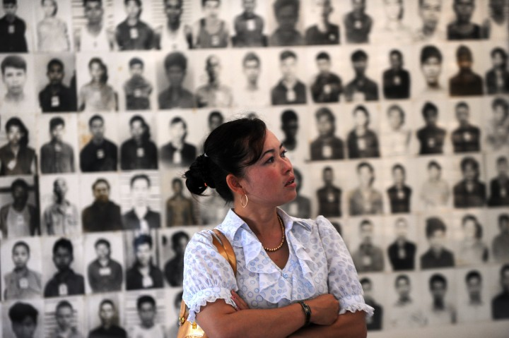 A Cambodian woman looks at portraits of victims of the Khmer Rouge at the Tuol Sleng genocide museum in Phnom Penh.