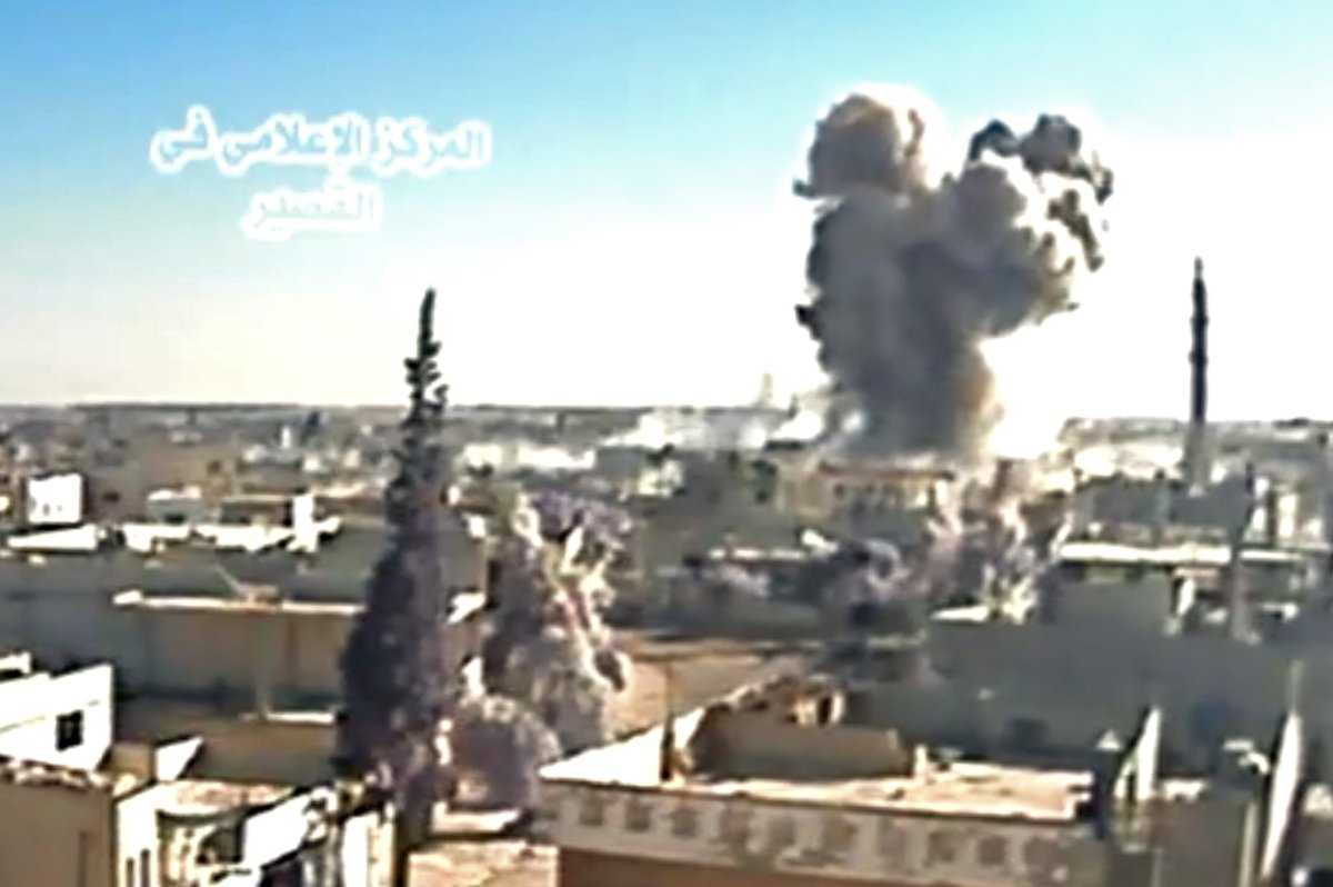 A image grab taken from a video uploaded on Youtube by Al-Qusayr Media Centre on May 26, 2013 allegedly shows smoke billowing from buildings in the city of Qusayr, in Syria's central Homs province, following an airstrike by government forces.