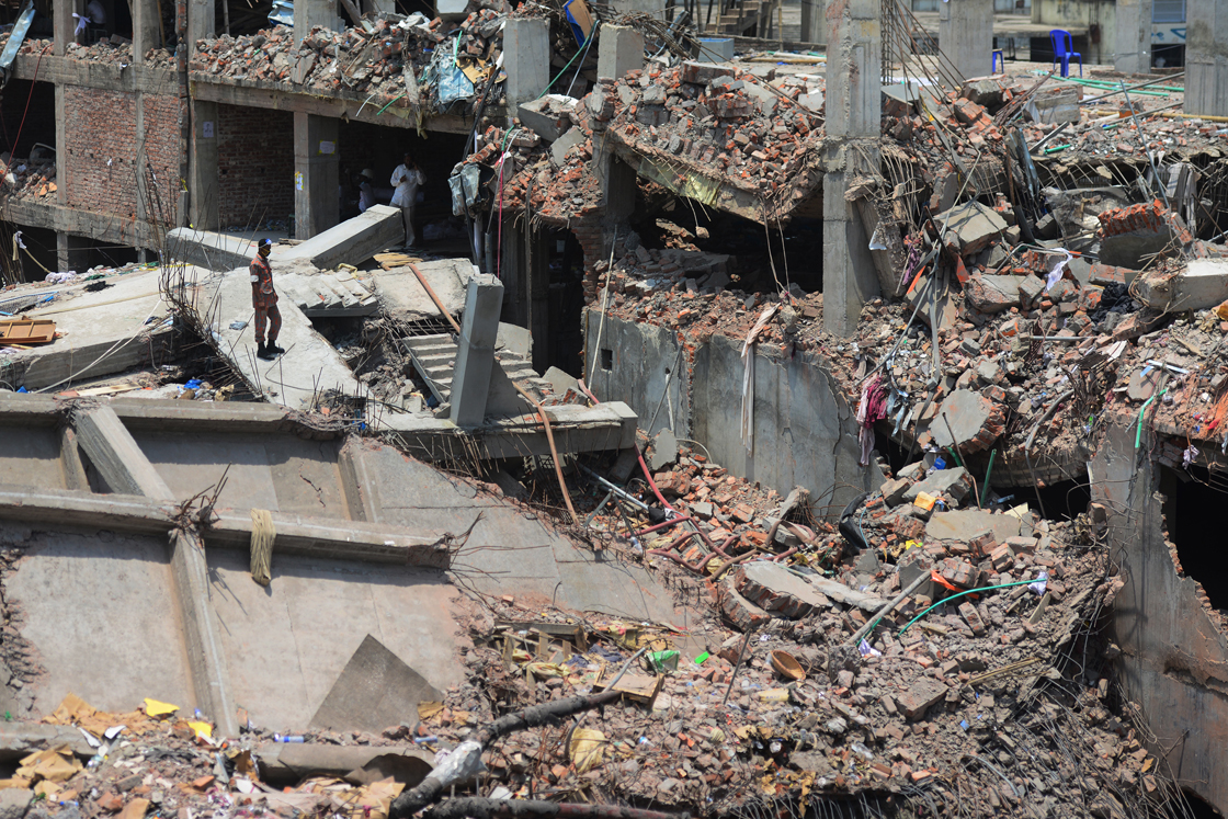 A Bangladeshi firefighter stands amid the debris as rescue and army personnel continue recovery operations after the eight-storey building collapsed in Savar, on the outskirts of Dhaka, on May 3, 2013.