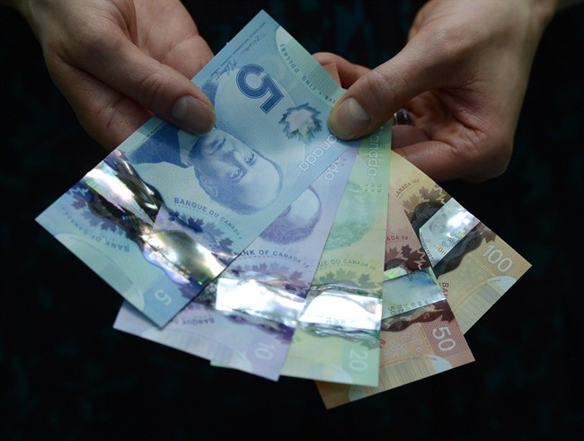 """Bank of Canada governor Stephen Poloz says he is """"absolutely open"""" to the idea of putting an identifiable woman back on Canada's currency, but that will have to wait until the next roll-out of bills."""