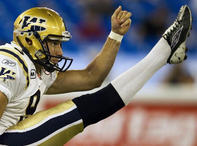 Winnipeg Blue Bombers punter Mike Renaud makes a kick in September 2011.