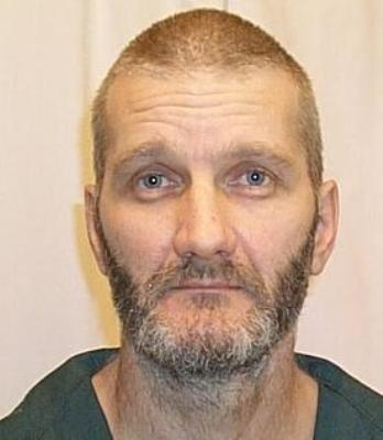 "Danny Edward Depew, 46, is 6'3"" tall and weighs approximately 160 lbs. He has grey hair, blue eyes and a fair complexion."