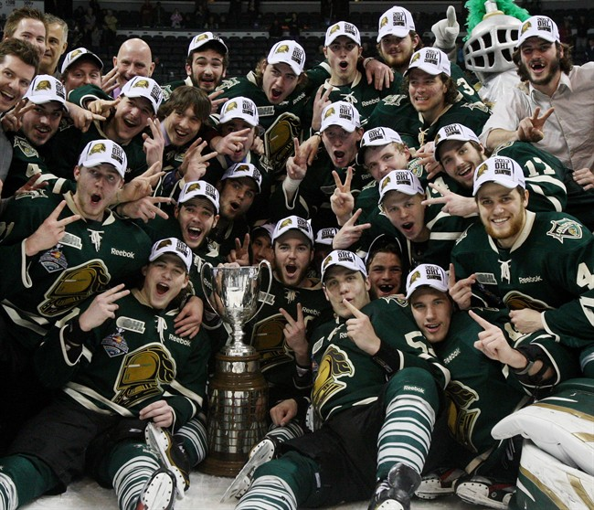 London's Knights surround the Ontario Hockey League Championship trophy after Game 7 action against the Barrie Colts on Monday, May 13, 2013 in London, Ont.