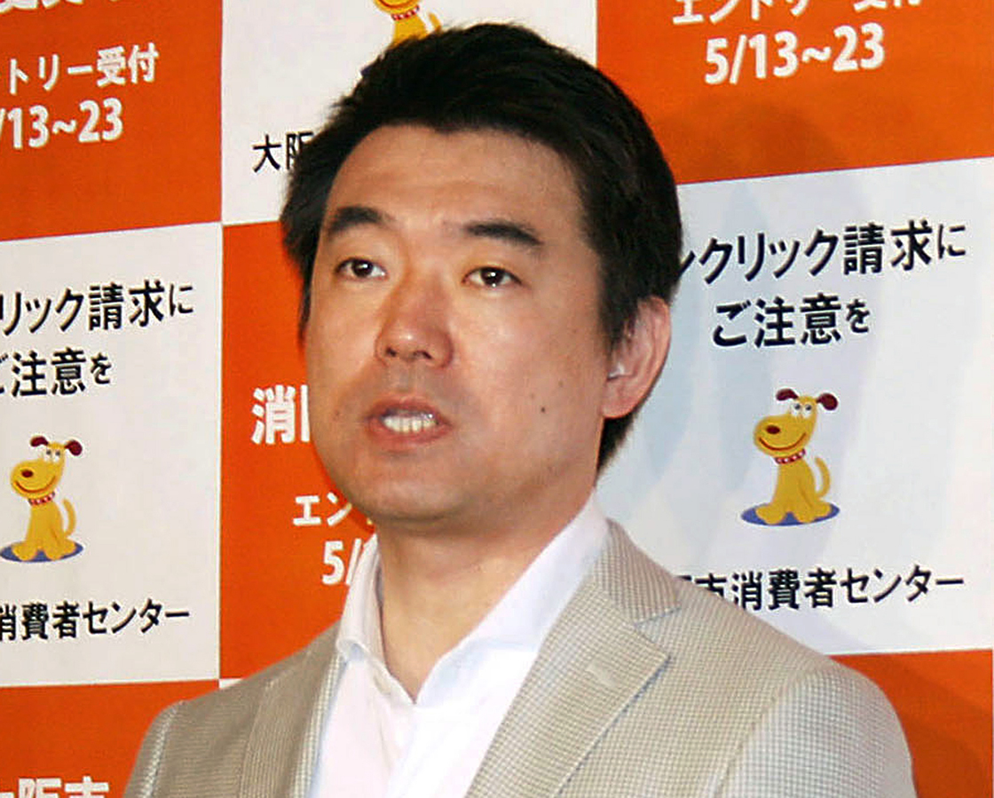 In this May 13, 2013 photo, Osaka Mayor Toru Hashimoto answers reporters' questions at the Osaka city office in Osaka, western Japan.